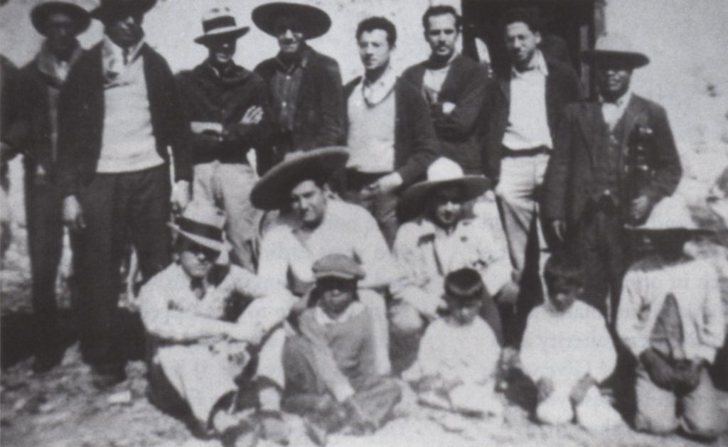 (fig. 2) Reuben Kadish, Philip Guston, and Jules Langsner (left to right, standing without hats) with Mexican friends in Santa Maria, near Morelia, Mexico, 1934. Photo, David McKee Gallery, New York